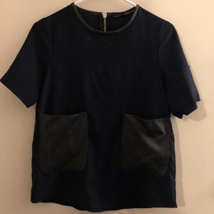 Zary navy blue blouse with faux leather pockets